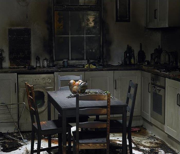 Kitchen covered in soot on the table, cabinets and floor