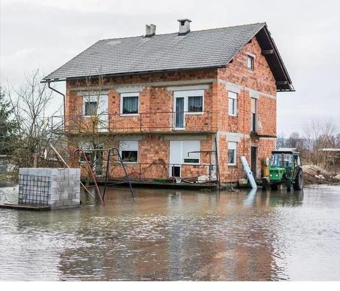 home surrounded by flood water