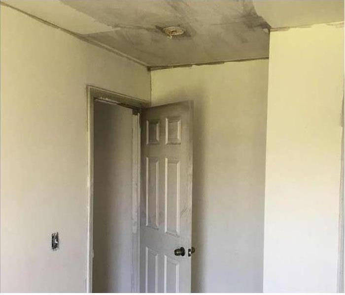 Soot and smoke damage on the ceiling of this home after a fire