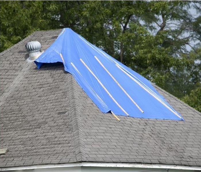top of roof with tarping on section