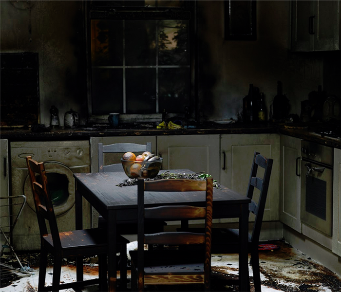 kitchen covered with soot from fire damage